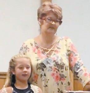 Charlene Tacket Mason sings at Cowan Primitive Baptist Church with her granddaughter Chesnee Kruze Mason.