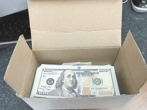 Sheriff 's deputies say the Millstone house held boxes full of counterfeit money.