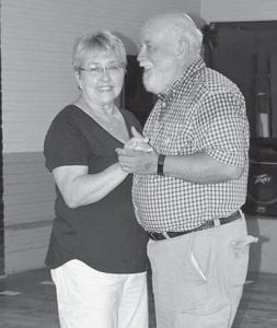 Mike and Marcia Caudill are pictured in a dance.