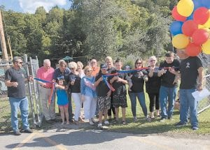Balloons hovered over Whitesburg Mayor James Wiley Craft as he led the ribbon-cutting ceremony for the new Sensory Park being developed next to the city's swimming pool.