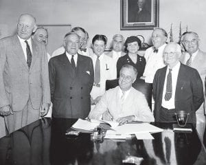 Social Security law is 83 years old Eighty-three years ago this month — on August 14, 1935 — President Franklin D. Roosevelt signs the Social Security bill in Washington D.C. From left, are: Chairman Doughton of the House Ways and Means Committree; Sen. Wagner, D-N.Y, co-author of the bill, Secretary Perkins, Chairman Harrison of the Senate Finance Committe, Rep. Lewis, D-Md., co-author of the measure. (AP photo)