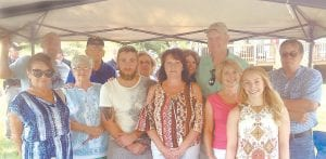 Members of the family of late Kentucky State Police Trooper Roger Wayne Collier attended the unveiling of a sign dedicating a bridge on U.S.119 in his honor. Pictured are (front row, from left) cousin Joyce Scott, Middlesboro; sister-in-law Valus Collier, Cumberland; grandson Blake Watts, Cumberland; daughter Diane Collier Watts, Partridge; daughter-in-law Jenny Collier, Somerset; granddaughter Jill Collier, Lexington; (back row, from left), son-in-law Rick Watts, Partridge; brother Orville Collier Jr., Cumberland; wife Wanda Collier, Partridge; cousins Tammy Calloway Charles and Danny Calloway of Knoxville, Tenn., and cousin Jimmy Darrell Scott of Oven Fork.