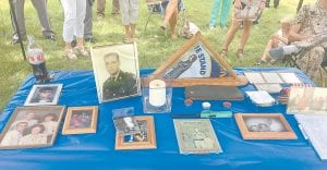 A table filled with old family and work photos and other items greeted visitors to the ceremony honoring late Kentucky State Trooper Roger Wayne Collier of Partridge.
