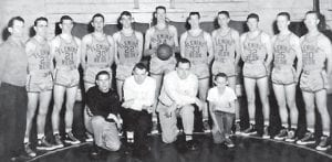 Pictured is the 1955-56 Fleming-Neon High School basketball team. Standing (left to right) are coach P.M. Armstrong, T. Bentley, L. Kuhl, J.W. Vanover, J.P. Graham, Acie Hall, H. Johnson, C. Creech, R. Whitaker, B. Potter and Leon Sergent. Kneeling are B. Cook, manager; John Morgan, assistant coach, Dave Hurst, assistant coach; M. Potter, manager. This team won 17 games and lost 8 and finished the season as runner-up of the 53rd District.