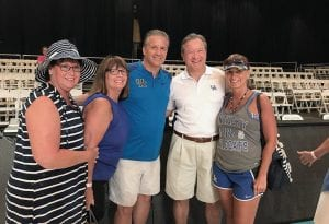 """Guy Ramsey, director of stratetic communications for UK athletics, knows fans like these fans with John Calipari in the Bahamas are """"who made UK sports"""" what they are."""
