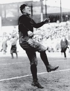 Jim Thorpe of the Carlisle Indian School gets off a kick during warm-ups before a game in this 1912 photo. Thorpe scored 25 touchdowns and 198 points that year in leading his team to the national collegiate championship. (AP Photo)
