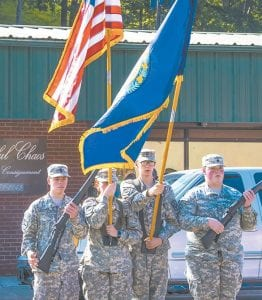 Members of the Letcher Central JROTC Color Guard present the colors at the beginning of the Jenkins Homecoming Days parade.