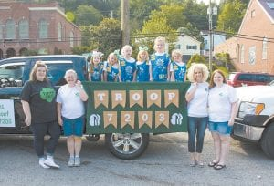 Jenkins's newly-formed Girl Scout troop prepared for a ride through the Jenkins Homecoming Day Festival parade. From left, troop assistant leaders Stachia and Barbara Collins; scouts Allison Anderson, Violet Jackson, Jayda Collins, Shelbi Jackson, Nirvana Niece and Megan Hall; assistant leader Alissa Wright and troop leader Debbie Anderson.