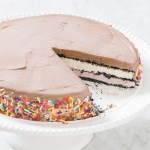 """This photo shows a basic ice cream cake. This recipe appears in the cookbook """"The Perfect Cake."""" (Daniel J. van Ackere/America's Test Kitchen via AP)"""