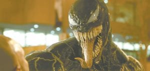 """This image released by Sony Pictures shows a scene from """"Venom,"""" in theaters on Oct. 5. (Sony Pictures via AP)"""
