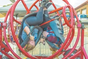 Randi Wampler, left, and Madison Buchanan took a spin on a ride at Neon Area Days festival held in downtown Neon over the weekend. More photos inside. (Photo by Chris Anderson)