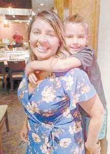 Ashley Tacket Ellis is pictured with her son, Cade Ellis.