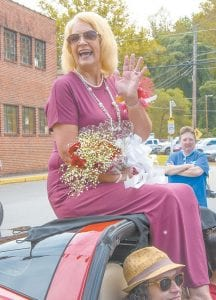 Neon Area Days Parade Grand Marshal Glenda Fleming smiles and waves during the parade.