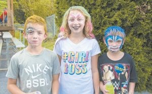 Briar Sergent, Carlee Sexton and Allan Jones showed off their painted faces and colored hair at Neon Area Days last weekend.