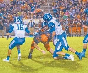 Letcher Central's Wil Parks and Jonathan Sergent teamed up for a tackle at Union High in Virginia while teammate Wyatt Ison stood ready to assist. The Cougars are scheduled to host Pike County Central this Friday night at Ermine.