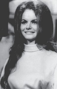 """Hers was first song to top both country and rock charts With her career-defining hit song, 23-year-old Jeannie C. Riley accomplished a crossover feat that no other woman would match for another dozen years: On September 21, 1968, she became the first female performer to top the Billboard Country and Pop charts simultaneously, with """"Harper Valley P.T.A."""" Perhaps never in pop history has one voice been more right for one song than Jeannie C. Riley's was for """"Harper Valley P.T.A."""" Indeed, it was her speaking voice, and not her singing, that got Riley noticed and picked out for the song. She had come to Nashville from her native Anson, Texas, in her early 20s to pursue a singing career, but it was on her day job as a receptionist at that she was noticed by the legendary country-music record producer Shelby Singleton. Recognizing her voice as perfect for the protagonist in songwriter Tom T. Hall's crypto-feminist tale of a small-town Southern widow's fight for her right to wear her skirts short and her heels high, Singleton had Riley record """"Harper Valley P.T.A."""" as her first professional demo, which was released as a single that charged up the Pop and Country charts in mid-summer 1968. — The History Channel Country music singer Jeannie C. Riley of """"Harper Valley PTA"""" in 1968. (AP)"""