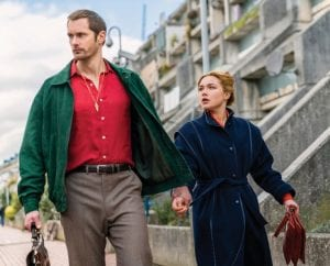 """This image released by AMC shows Alexander Skarsgard, left, and Florence Pugh in a scene from the series """"The Little Drummer Girl,"""" premiering on Nov. 19. (Jonathan Olley/AMC/Ink Factory via AP)"""
