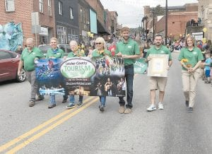 LEADING THE PARADE — The Mountain Heritage Festival Parade was held Saturday in downtown Whitesburg. Grand marshals were Letcher County Tourism Commission members, pictured from left, Richard Brown, Missy Matthews, Maxine Quillen, Sandy Hogg, Winston Lee, Kyle Smith and Jessica Howard. (Photos by Sally Oakes)