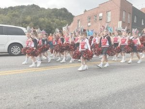 The Martha Jane Potter Elementary School cheerleaders were dressed as baby sharks for the parade down Main Street.