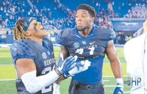 Josh Allen, right, celebrated with Benny Snell after UK beat South Carolina to move to No. 13 in the national rankings. Allen now has 20 ½ career sacks and Snell 40 touchdowns going into Saturday's game at Texas A&M. The game airs on ESPN at 7 p.m. (Jeff Houchin Photo)