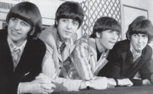 """The Beatles, from left, in 1966: Ringo Starr; Paul McCartney; John Lennon; and George Harrison appear at a press conference in New York. Giles Martin says his father, producer George Martin, would wince whenever a fan would say that the """"White Album"""" was their favorite Beatles' record. The late George Martin would recall how tough it was to make the sprawling double album, titled """"The Beatles"""" but given its familiar nickname because of the all-white cover. His son is in charge of a 50th anniversary repackaging that is due out Nov. 9. (AP Photo)"""
