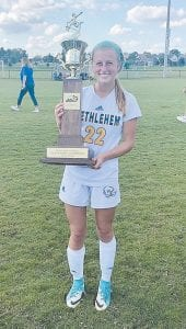 Buckley Ann Sparks is shown holding the All A state soccer champion trophy. Buckley is a 17-year-old junior at Bethlehem High School, and starts as the outside midfi elder. She is the daughter of Keith and Michelle Sparks of Bardstown. Her grandparents are Ralph and Judy Buckley of Bardstown, and Buck and Shirley Sparks of Mayking.