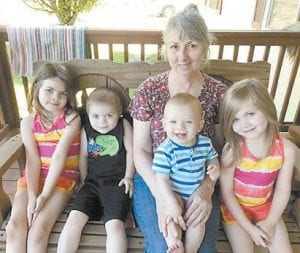Jeanette Yonts's first childhood friend, Velma Profitt Caldwell, is pictured with her grandchildren.