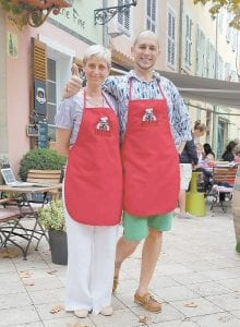 Caroline and Lionel Thomsin wearing Black Sheep Brick Oven Bakery Aprons at their cafe.