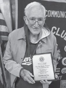 Jack Morgan received an awards plaque for his service to the Neon Lions Club, of which he is a longtime member.