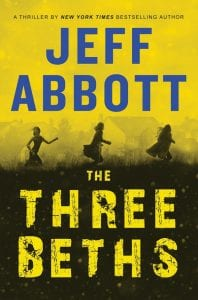 """This cover image released by Grand Central Publishing shows """"The Three Beths"""" by Jeff Abbott."""