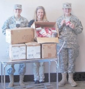 On Oct. 8, Letcher County Central High School JROTC Cadets Emily Collier and Molly Collins received a donation of wristbands from Price Less Foods manager Pam Maness to show the grocery store's community support.
