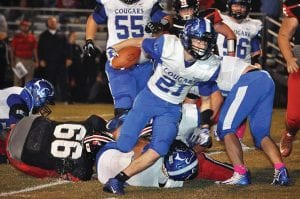 Letcher County Central's Hunter Campbell (21) breaks free for one of his 20 rushes during the Cougars' 21-20 win over Whitley County. Campbell rushed for 124 yards and two TDs. (Photo by Dean Manning)