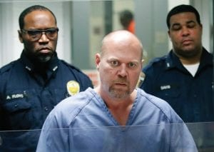 Gregory Bush was arraigned on two counts of murder and 10 counts of wanton endangerment last week in Louisville. Bush shot and killed two African-American customers at a Kroger grocery store October 24 and was arrested as he tried to run away. (Scott Utterback/Courier Journal via AP)