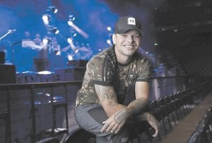 """Country singer Kane Brown poses in Nashville, Tenn. Brown's 2016 self-titled debut album and its deluxe release last year spawned two multi-platinum hits, """"Heaven"""" and """"What Ifs,"""" but the breakout star was snubbed at the Country Music Association Awards this year. Brown's new album, """"Experiment,"""" will go on sale Friday, November 9. (AP Photo/Mark Humphrey)"""
