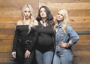 Ashley Monroe, from left, Angaleena Presley and Miranda Lambert of the Pistol Annies pose in Nashville.