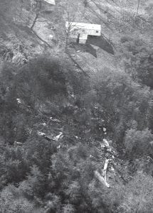 This November 16, 1970 photo shows portions of the wreckage of a DC-9 chartered jet that carried 75 persons, including most of the Marshall University football team, to their deaths. The crash occurred less than 24 hours earlier on a hillside in Kenova, West Virginia, just west of the Tri-State Airport runway in Huntington. (AP Photo)