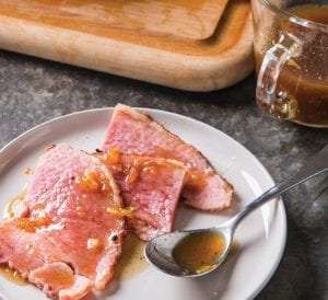 """This recipe for glazed spiral-sliced ham appears in the cookbook """"All-Time Best Holiday Entertaining."""" (Joe Keller/America's Test Kitchen via AP)"""