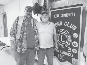 "Neon Community Lions Club President Jason ""Tree"" Adams presents Lion Jimbo Breeding his 35-year membership chevron."