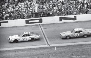 "Above, David Pearson (21) crosses the finish line and gets the checkered victory flag ahead of Richard Petty (43) at the Daytona Speedway in Daytona, Florida on July 4, 1974. Pearson, who died this week at age 83, passed Petty on the last lap for the victory, his third consecutive ""400"" win at the Daytona Speedway. Below, Pearson, right, and Petty in Atlanta in March 2009. (AP Photos)"