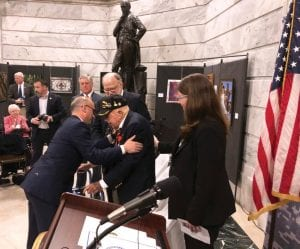 French Consul General Guillaume Lacroix, left, embraces retired Lt. Col. William Pollard after awarding him the French Legion of Honor on Monday in Frankfort. Pollard is a 100-year-old World War II veteran who lives in Kentucky. He was part of the Allied invasion of France in 1944. (AP Photo/Adam Beam)