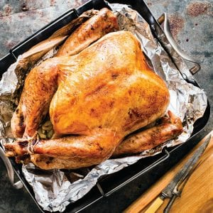 """This recipe for this roast turkey appears in the cookbook """"ATB Holiday Entertaining."""" (Daniel J. van Ackere/America's Test Kitchen via AP)"""
