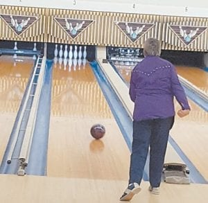 Kim Day demonstrates her bowling skill. Her birthday is November 25.