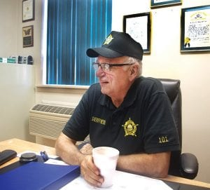 Sheriff Danny Webb shares a laugh in his office. (Photo by Sam Adams)