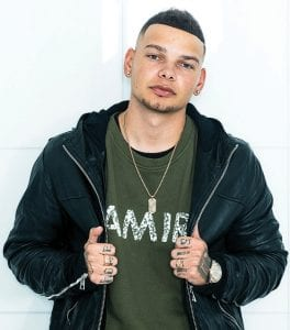Country singer Kane Brown came from humble beginnings to become one of the brightest new singers in music and arguably country music's most successful act of the year. (Photo by Drew Gurian/ Invision/AP)