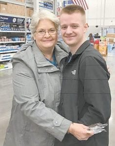 Jeanette Tacket is pictured with Eric Brown, who's serving in the Air Force.