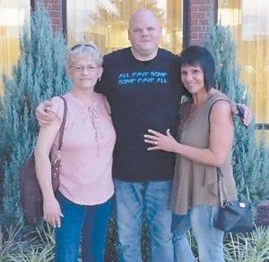 Teresa Noble Pease, her son Joshua Pease and Jennifer Noble Holbrook.