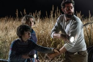 "Noah Jupe, from left, Millicent Simmonds and John Krasinski in a scene from ""A Quiet Place."" With just a $17 million budget, John Krasinski's horror hit grossed $340.7 million worldwide. It was the biggest original hit of a year typically dominated by sequels, superheroes and reboots. Of course, ""A Quiet Place"" will get its own sequel, slated for release in 2020. (Paramount Pictures via AP)"