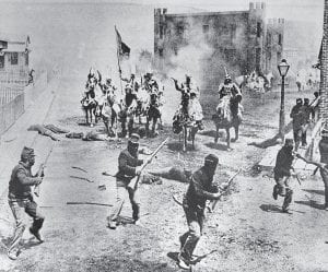 "This 1914 file photo shows a scene from D.W. Griffith's ""Birth of a Nation"" movie depicting Ku Klux Klan members riding horses against soldiers, filmed in the Hollywood section of Los Angeles. The groundbreaking 1915 film, widely regarded as one of the most corrosively racist ever made, is viewed ever more harshly as the years pass. (AP Photo)"