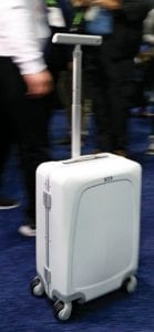 Bag rolls on its own A man demonstrates the Ovis Suitcase at the ForwardX booth at CES International in Las Vegas. The suitcase will automatically follow the user at their side as they walk. (AP Photo)
