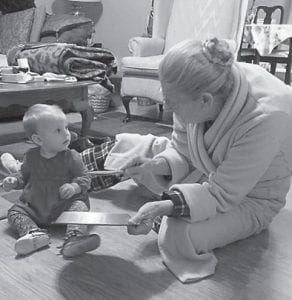 Bertha Dye is pictured with one of her great grandbabies.